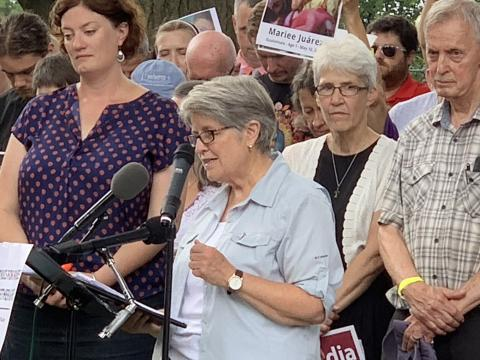 LCWR staff member Sister Ann  Scholz, SSND leads part of the prayer in DC