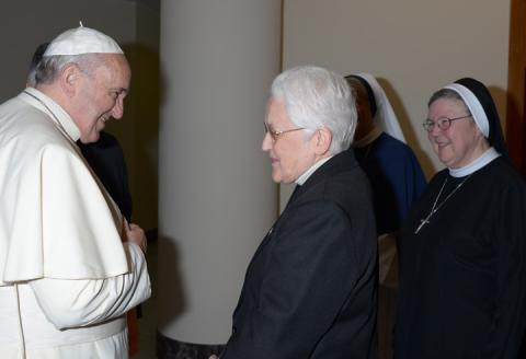 Sister Sharon Holland, IHM greets Pope Francis prior to press conference